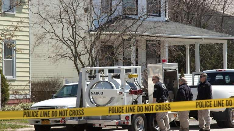 Police outside a Lynbrook home after residents found