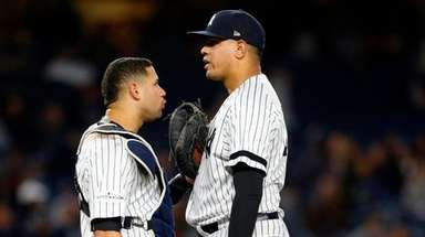 Dellin Betances #68 and Gary Sanchez #24 of