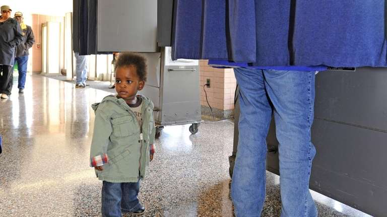 Fourteen-month-old Joshua Kennard waits for his mom, Robyn