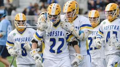Hofstra midfielder Alex Moeser is congratulated by attacker