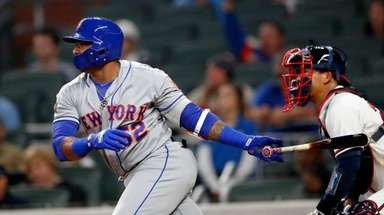The Mets' Yoenis Cespedes drives in the go-ahead