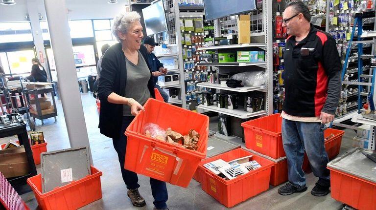 Longtime customer and volunteer Cindy Ellner carries a