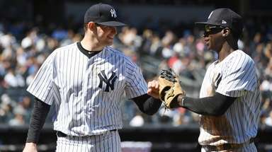 Yankees starting pitcher Jordan Montgomery and shortstop Didi