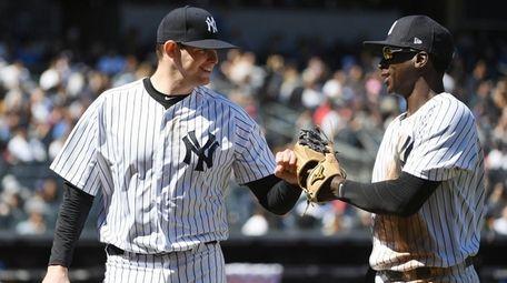 Yankees starting pitcher Jordan Montgomery and shortstop Didi