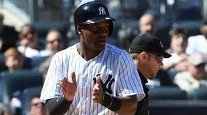 Yankees third baseman Miguel Andujar reacts after he