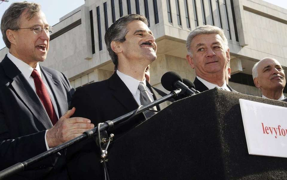 Suffolk County Executive Steve Levy, second from left,