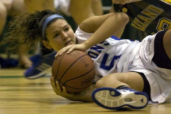 Division's Nicolette McCreary dives for a loose ball