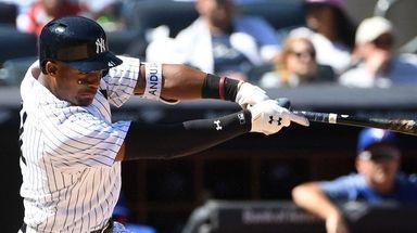 New York Yankees third baseman Miguel Andujar hits