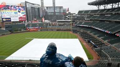 Atlanta Braves fans look out over the covered