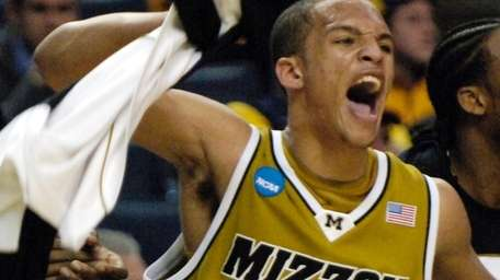 Missouri's Michael Dixon reacts during the second half