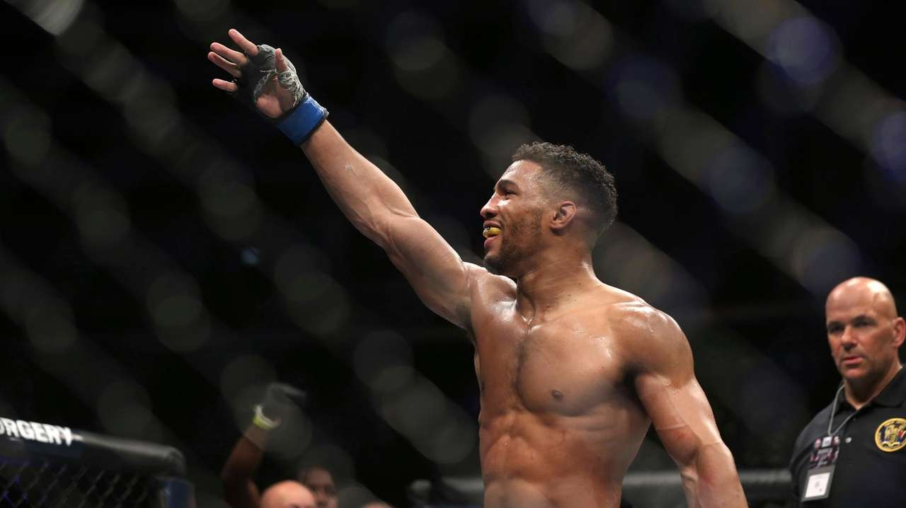 Kevin Lee celebrates his win over Edson Barboza