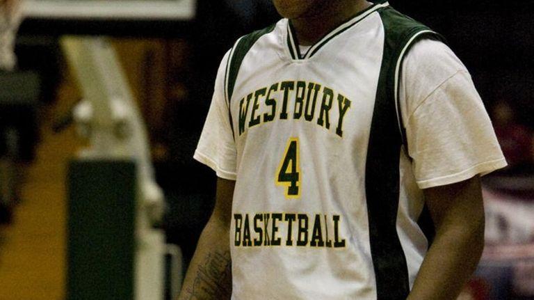 Westbury's Sheldon Hagigal brings the ball up court