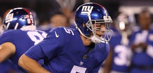 Giants quarterback Davis Webb looks to hand off