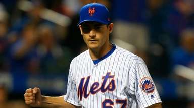 Mets pitcher Seth Lugo reacts after an inning-ending