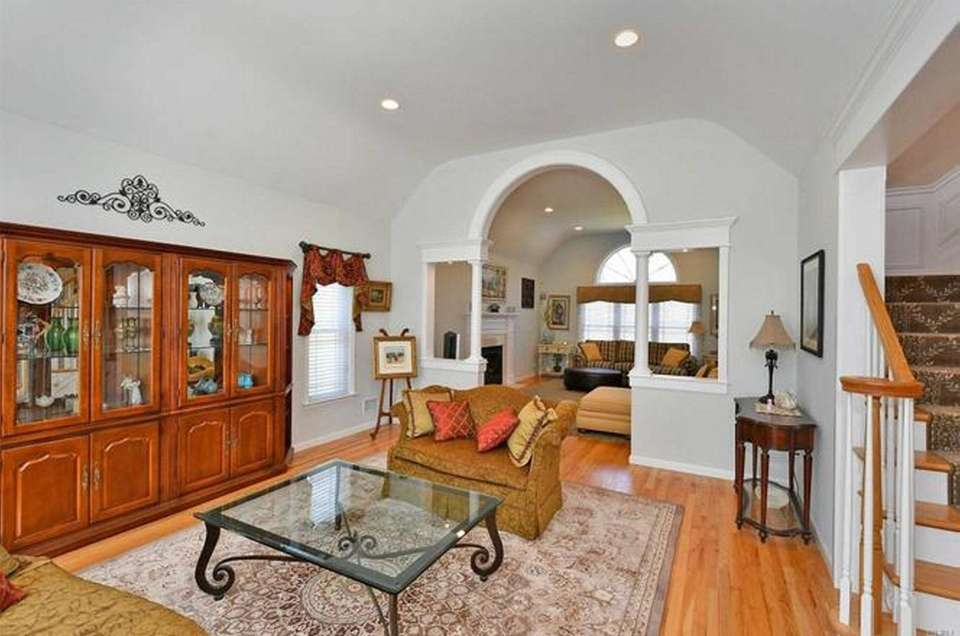 Beyond the two-story entry in this South Huntington