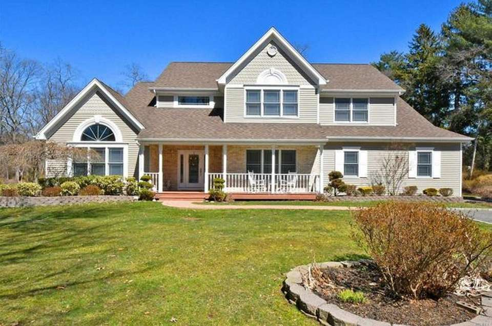 This South Huntington Colonial includes five bedrooms and
