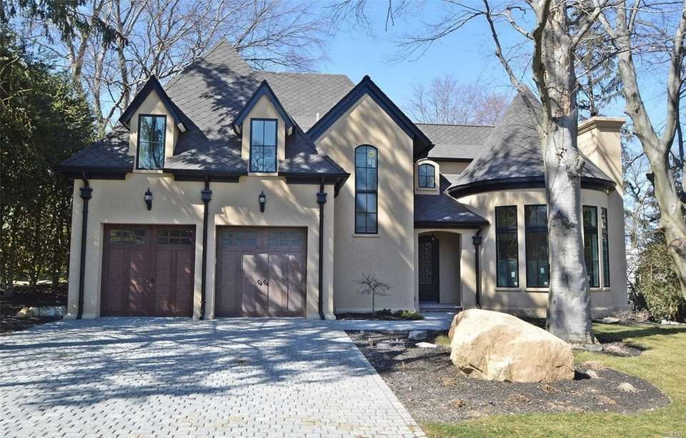 This newly constructed home in Mill Neck features