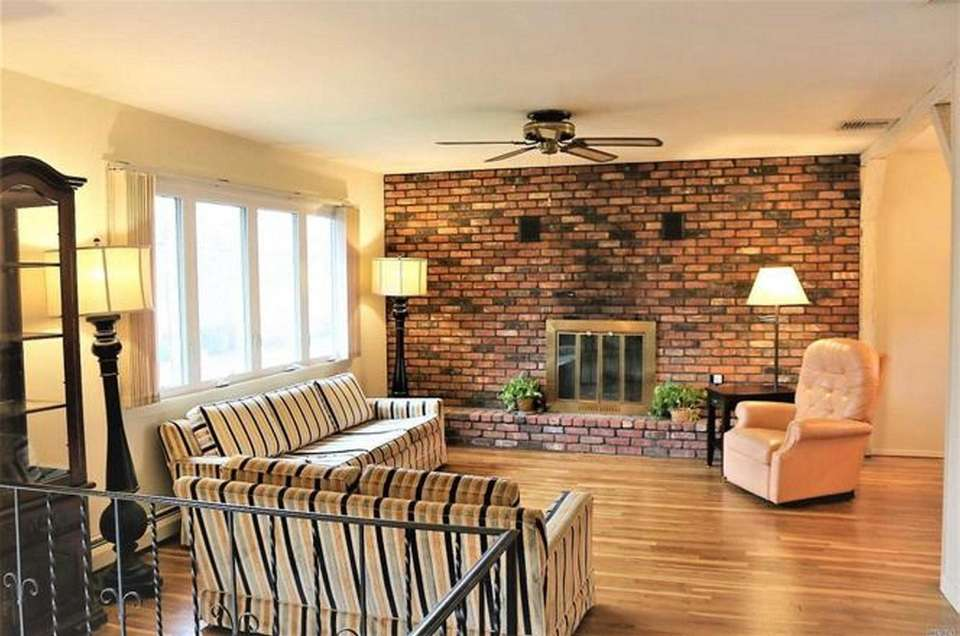 The living room in this Sayville high-ranch boasts