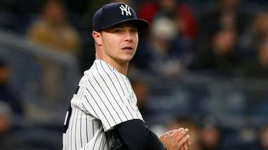 Yankees pitcher Sonny Gray looks on during a