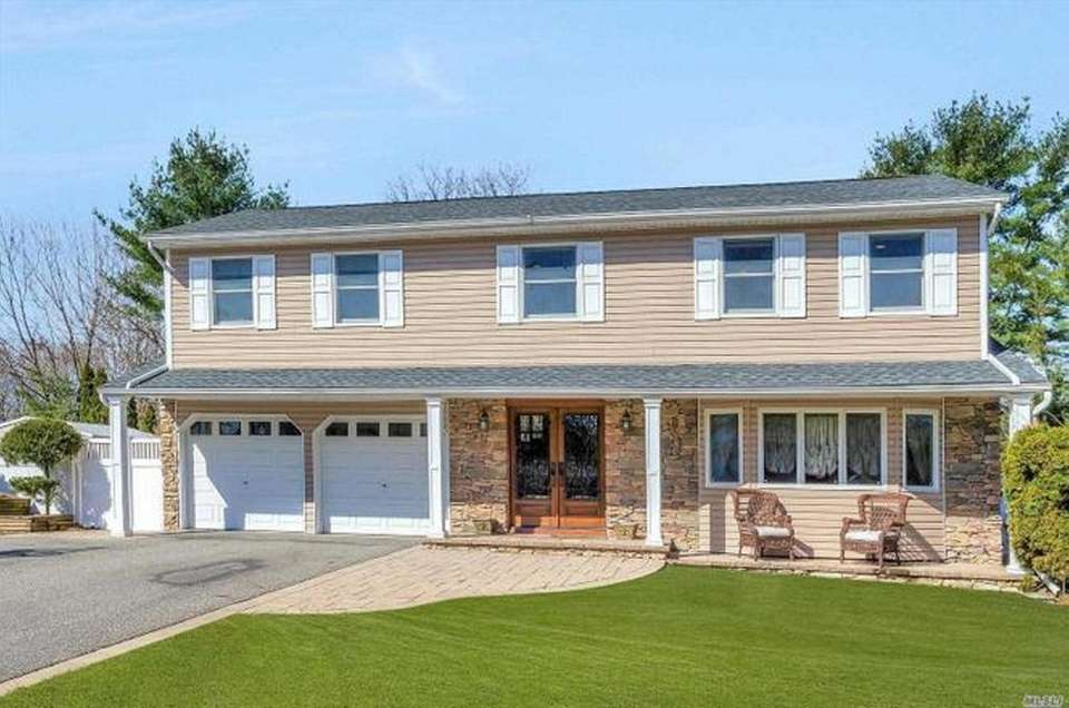 This Hauppauge Colonial includes four bedrooms and 3