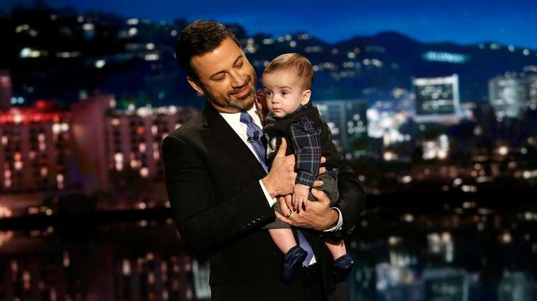 Jimmy Kimmel holds his son Billy on a