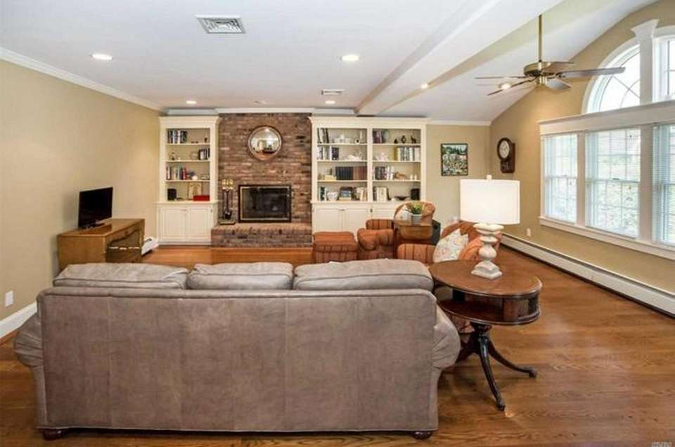 The family room in this Garden City Colonial