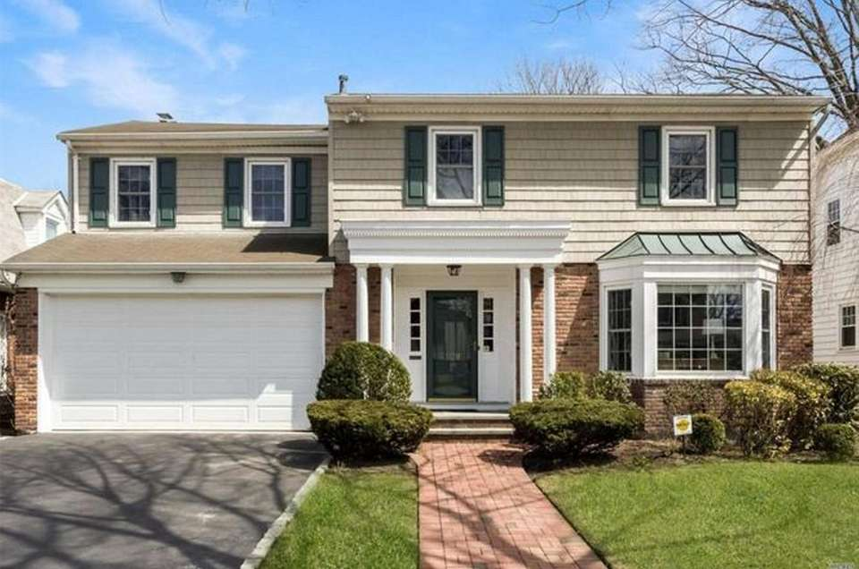 This Garden City Colonial features four bedrooms and