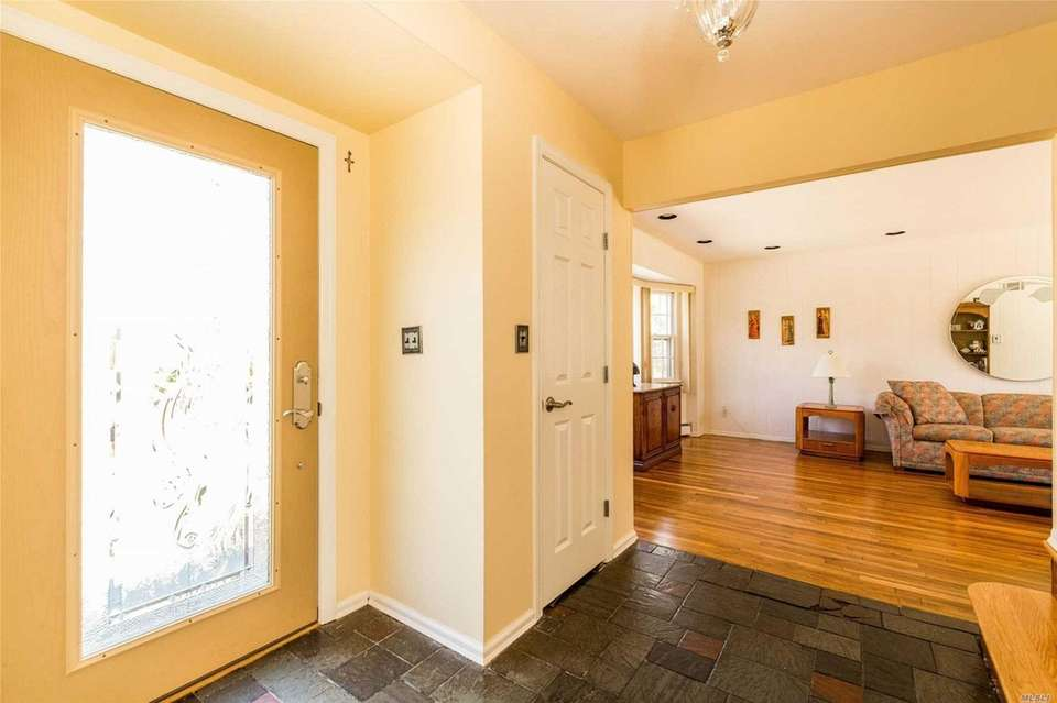 Beyond the entry foyer in this Huntington Colonial