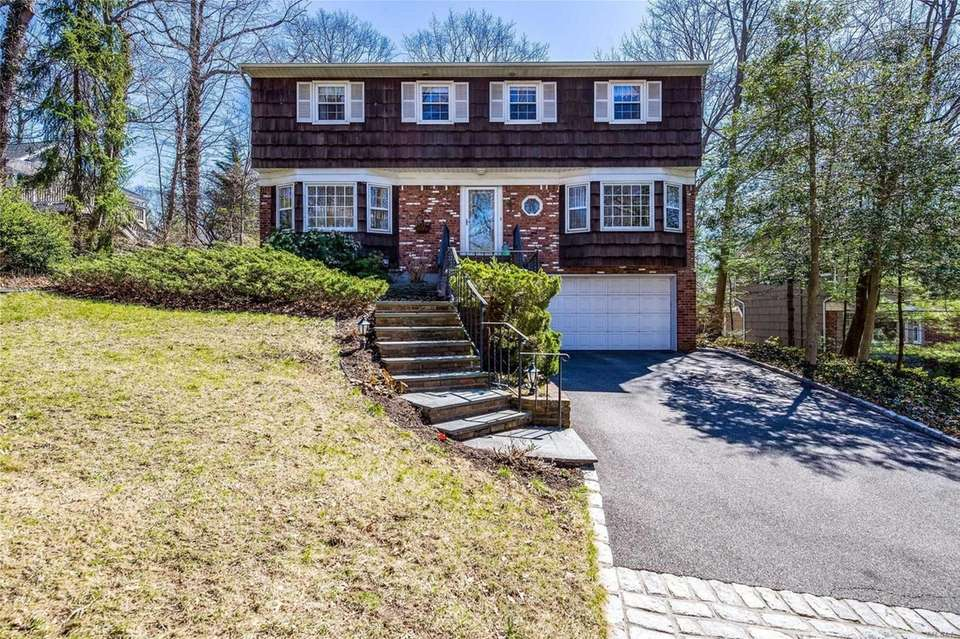This Huntington Colonial includes four bedrooms and 2