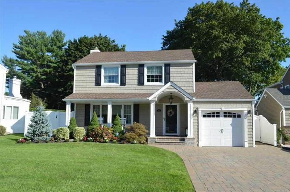 This North Merrick Colonial has three bedrooms and