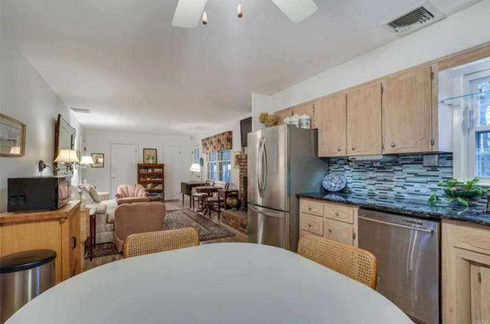 The granite kitchen in this Oakdale Colonial opens