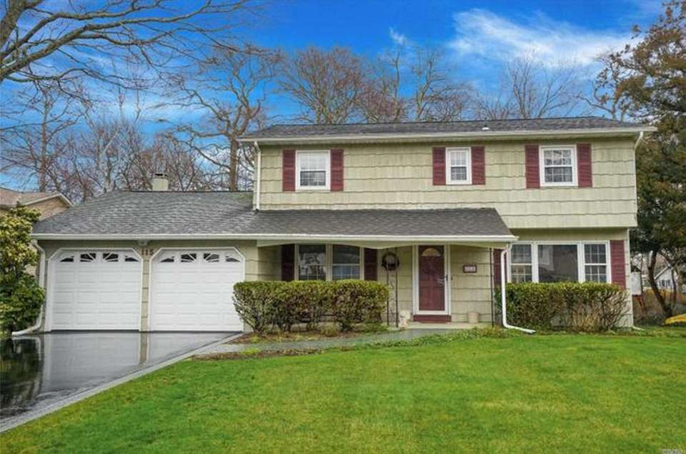 This Oakdale Colonial includes four bedrooms and 2
