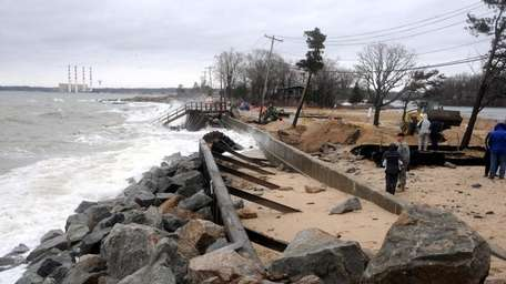 Waves crash over collapsed seawall in Asharoken. (March