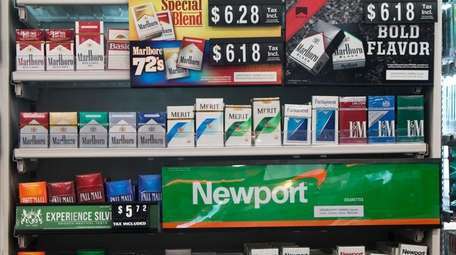 Packs of cigarettes are offered for sale at