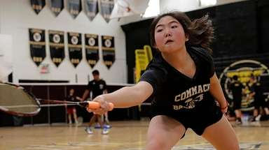 Commack's Wongjung Choi reaches for the forehand return