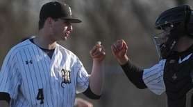 Anthony Fontana #4, Wantagh lefthanded pitcher, left, gets