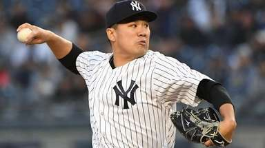 Yankees starting pitcher Masahiro Tanaka delivers a pitch