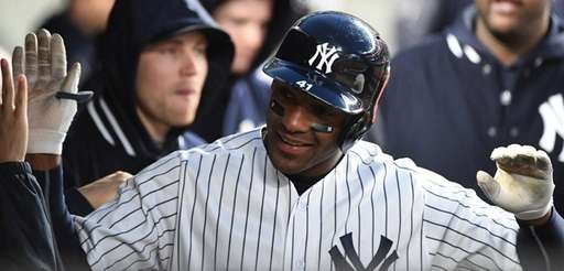 Yankees third baseman Miguel Andujar is greeted in