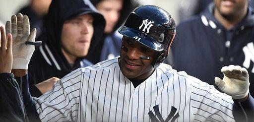 Yankees third baseman Miguel Andujar is greeted in