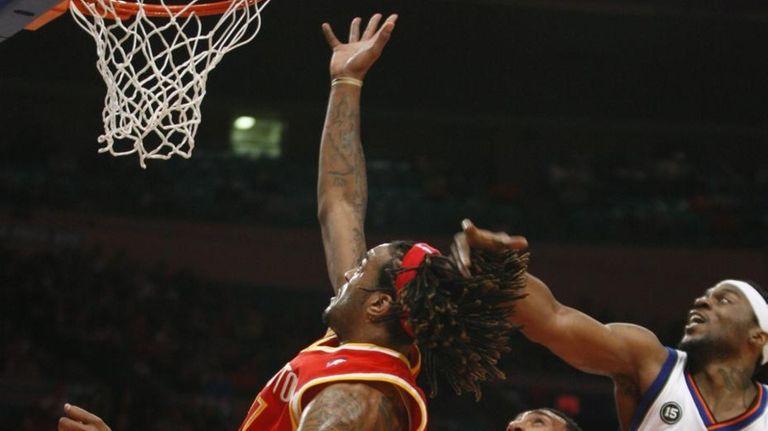 Houston forward Jordan Hill (27) tips the ball
