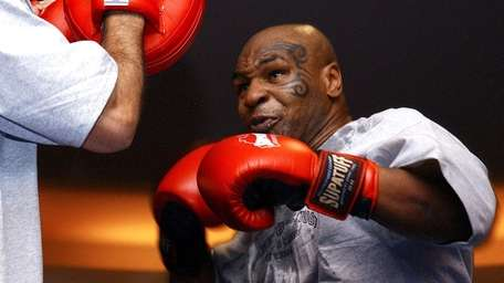 Former heavyweight boxing champion Mike Tyson spars during
