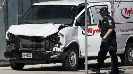 Police inspect the van allegedly used to kill