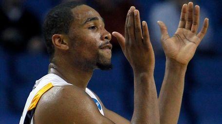 West Virginia's Da'Sean Butler reacts at the end