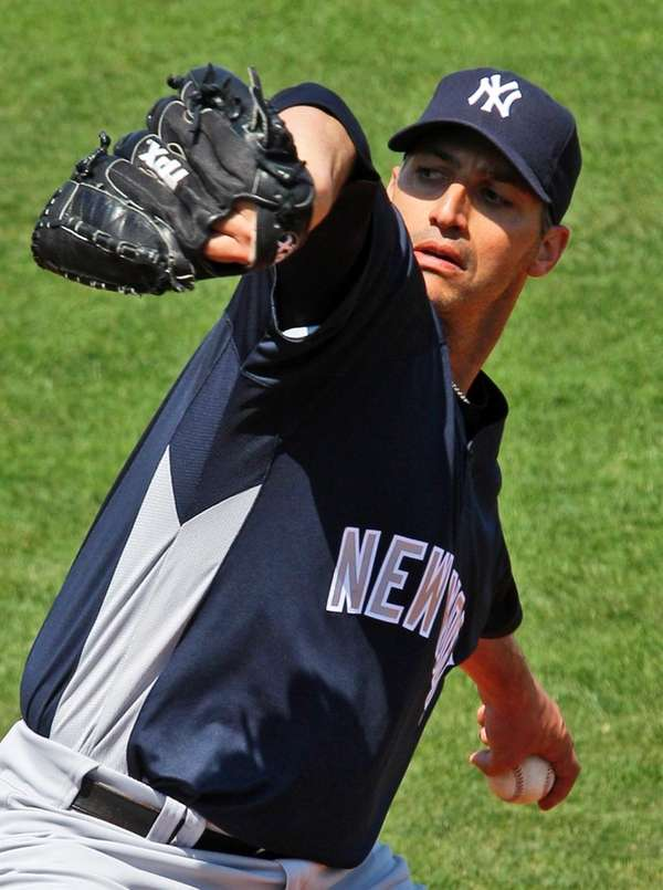 Yankees pitcher Andy Pettitte throws during a spring