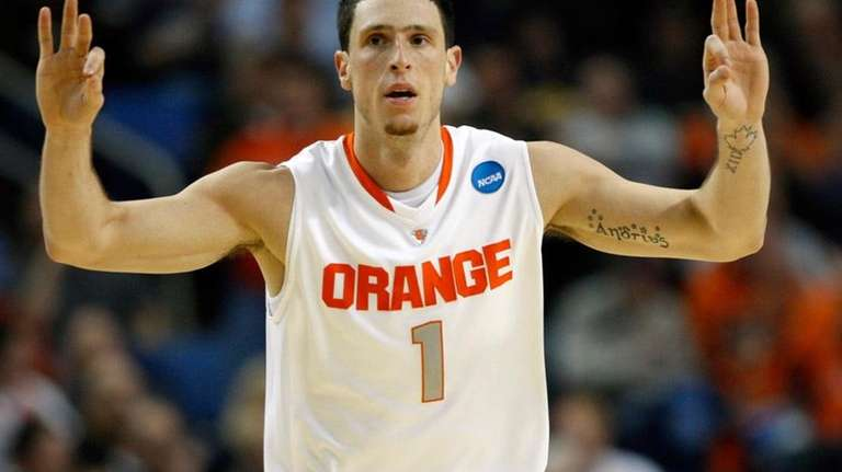 Syracuse's Andy Rautins signals against Gonzaga during the