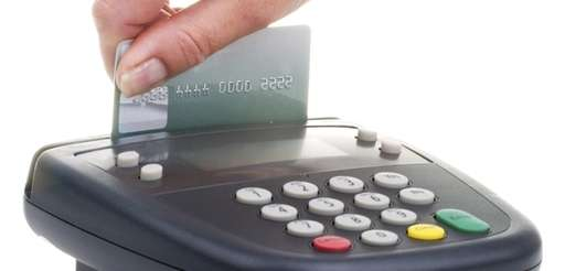 Customer swipes credit card on pin pad card
