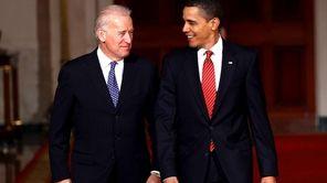 President Barack Obama arrives with Vice President Joseph