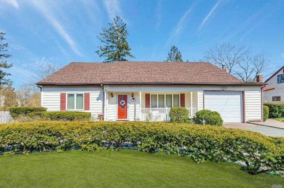 This Nesconset farm ranch offers four bedrooms and