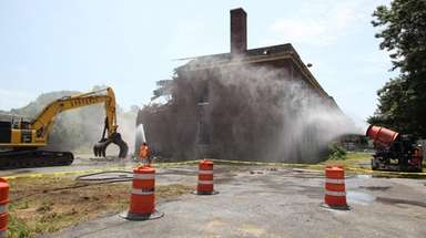Crews begin demolishing the Grand Street School in