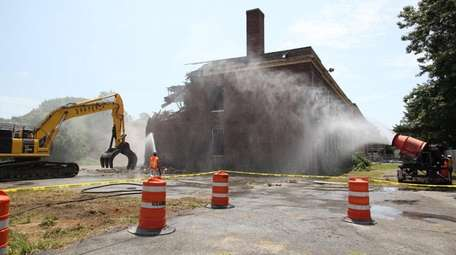 Crews begin demolishing the Grand Street School in